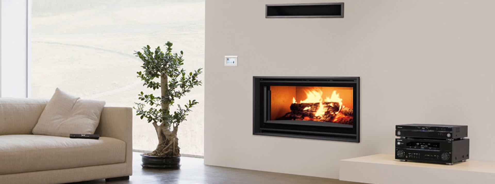 Carbel chimeneas y estufas de le a for Diseno de hogares a lena modernos